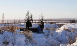 In this Oct. 27, 2010 file photo, Russian scientists Sergey Zimov and his son Nikita Zimov extract air samples from frozen soil near the town of Chersky in Siberia 6,600 kms (4,000 miles) east of Moscow, Russia. Photo: Arthur Max, Associated Press