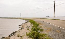 When tides are high and winds are blowing, Island Road sometimes becomes impassable. Isle de Jean Charles is vulnerable to hurricanes and flooding. The marsh is disappearing and seas are rising because of global warming. Photo: William Widmer, Redux for CNN