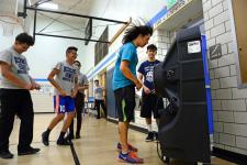 Gym teacher Neal Finch cools off in front of a large Portacool Cooling system set up to help cool off the gym during classes at KIPP Denver Collegiate High School on Sept. 24, 2018 in Denver. Photo: Helen H. Richardson, The Denver Post
