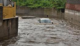 Photo: A car floating in a nala at Qutbllapur village, following heavy rain on the outskirts of Hyderabad on Wednesday. Photo: G. Ramakrishna