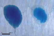 Aerial view of a lake on the Greenland Ice Sheet before, left, and after drainage, right. Credit: Thomas R. Chudley