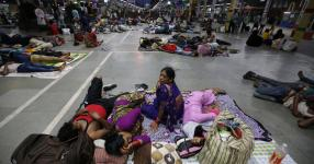 Stranded passengers in a railway station in Kolkata, India, in May after trains were canceled because of Cyclone Fani. Photo: Rupak De Chowdhuri, Reuters