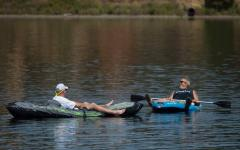 A just-retired Mark Wilson of East Sacramento, left, relaxes in a kayak while floating in Lake Natoma with his friend Danny Langdon of Tahoe Park on Thursday, August 3, 2017 in Sacramento, Calif. Sacramento set a heat-wave record Monday with 41 consecutive days at 90 degrees or warmer. Photo: Randy Pench