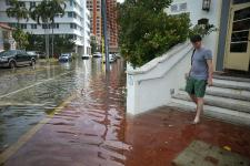 The nuisance flooding that accompanies seasonal high tides in parts of the Miami area will become more common as sea level rises. Photo: Joe Raedle, Getty Images